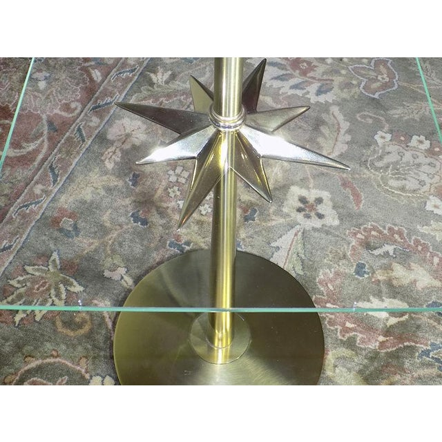 Rare Stiffel brass floor lamp with an unusual starburt form under the floating glass shelf. Probably 1960's vintage, was...