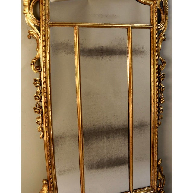 Circa 19th Century Louis XIV Style Gilt Wood and Gesso Mirror. Add a hint of Versaille to your home or office with this...