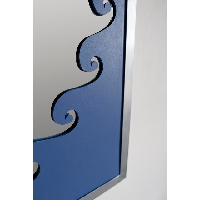 Hand-painted aluminum frame adorned with a vitruvian scroll detail. Shown in a textured white finish.