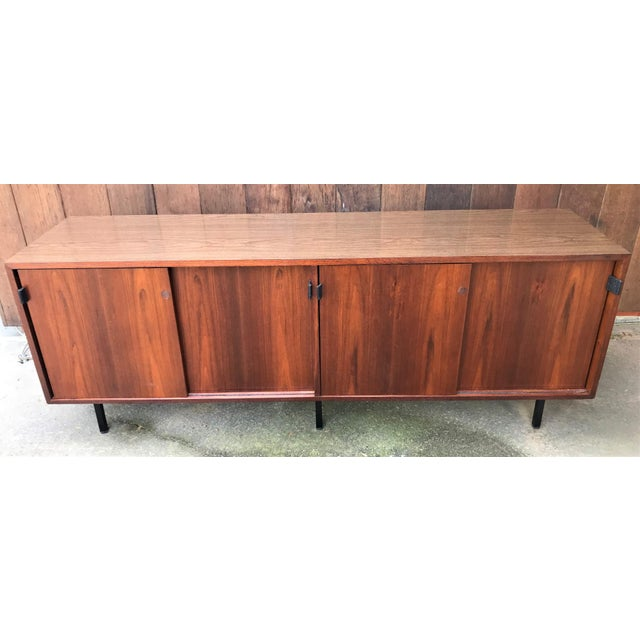 Vintage mid century modern Florence Knoll Credenza by Knoll Associates. (Has the original tag) Elevated by beautiful black...