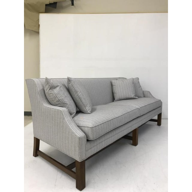 The Gallery Sofa is a first quality market sample that features a Springdown Medium Seat Cushion and a Luxdown Throw...