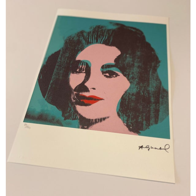 """The rare turquoise limited edition (83/125) lithograph titled """"Liz, 1964"""" by Andy Warhol. Stone signed, pencil numbered,..."""