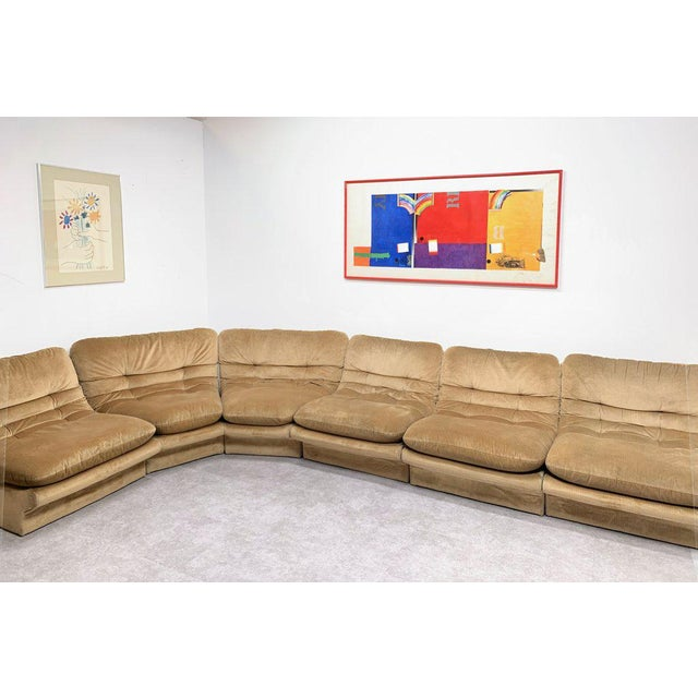 Tufted modular sofa attributed to Vladimir Kagan, upholstered in textured beige. Comprised of 6 individual pieces that can...