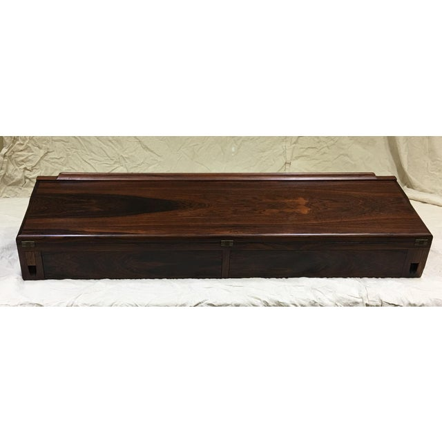 Absolutely beautiful Brazilian rosewood floating wall desk by Arne Hovmand-Olsen, made in Denmark. The craftsmanship on...