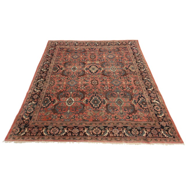 Crafted of hand-knotted wool, this Persian Mahal rug features an all-over floral and geometric design.