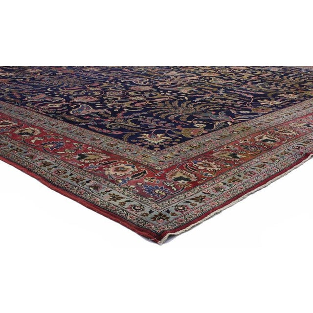 An excellent representation of Persian culture from the 19th century, this captivating Persian Mashad rug with traditional...