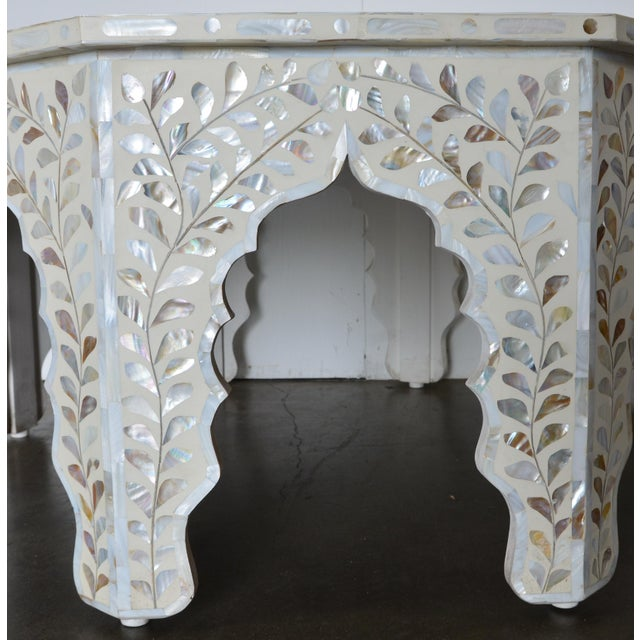 A wonderfully constructed and extremely laborious individually hand carved inlaid bone and mother of pearl table.