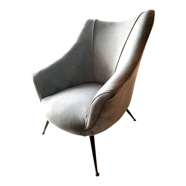 Pair of mid-century barrel shaped club chairs featuring tapering splayed metal legs and all new upholstery done in an...