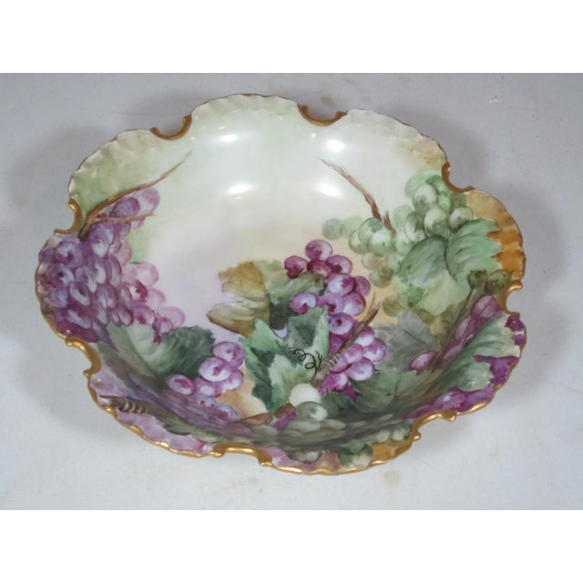Antique Handpainted Rosenthal scalloped bowl made in Germany. The bowl is elaborately decorated with grapes and gold accents.