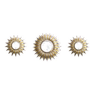 A Fanciful Set of 3 French Art Deco Silver and Gold Tole Sunburst Mirrors For Sale