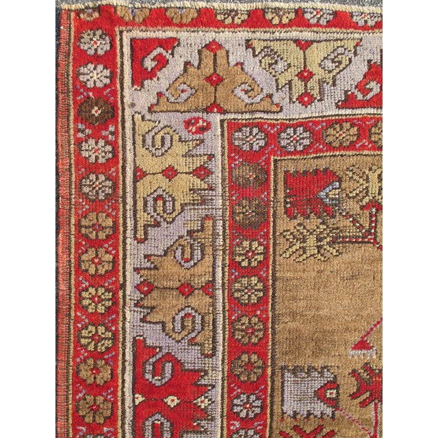 This Turkish tribal rug was woven in 1940s, Turkey. The emphasis with these rugs is on their colors, and those in this...