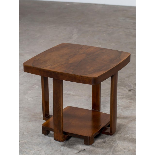 The chic profile of this Art Deco table circa 1930 is visible in the upper and lower tier joined by the four free floating...