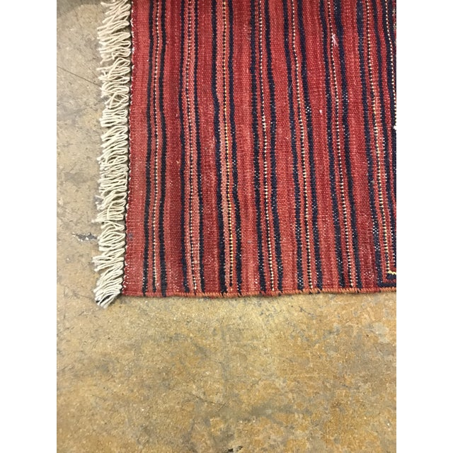 Beautiful large Afghan Kilim rug. Rich burgundy color with oranges, navy and ivory weave. 8 feet X 10 feet