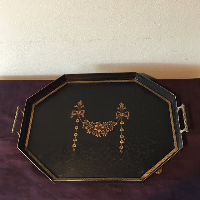 Gorgeous hand painted serving tray with brass lion feet perfect for holiday entertaining. This is a metal tray with a...
