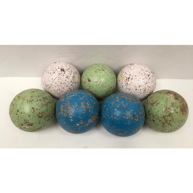 Awesome display item. Vintage set of seven wood painted bocce balls imported from Italy. Great decor colors -- celery...