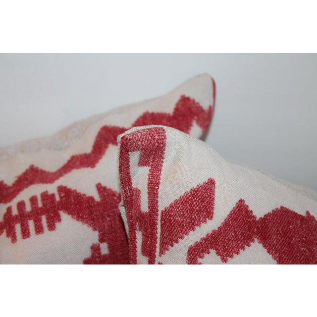 These amazing hand embroidered red threading on linen pillows are in fine condition. The pillows have side ties and down...