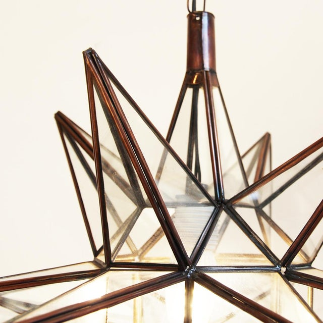 Moravian star lantern with beautiful metal work frame and clear glass inset. Great as a single star or in groupings....
