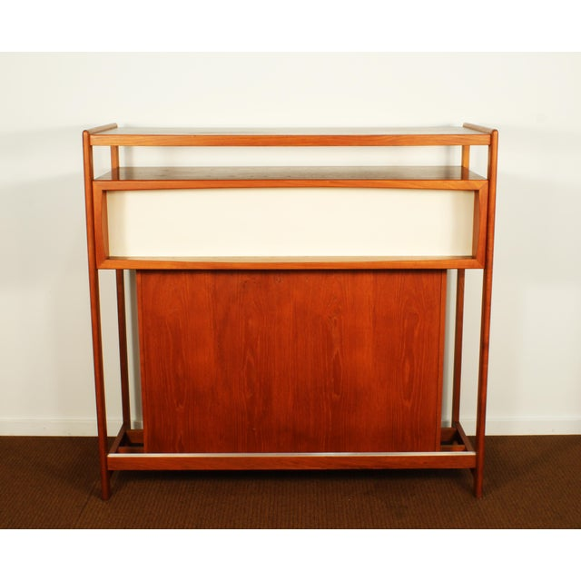 Incredible Danish teak dry bar by Dyrlund, circa 1960s. Abundant storage and features throughout including a pull-out ice...