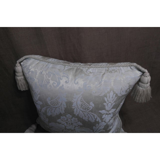 Silk damask Anichini throw pillow cream color back ground & white, with off white welt cord and large tassels, down and...