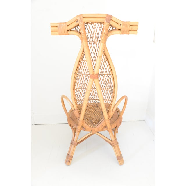Unusual Vintage Rattan Chair with a tall horn back .It was originally designed as a fishing chair so it's low to the ground.