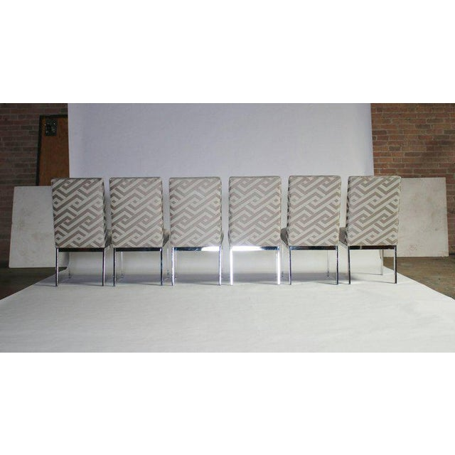 Set of six 1970s dining chairs by Milo Baughman for Design Institute of America newly upholstered in a platinum and cream...