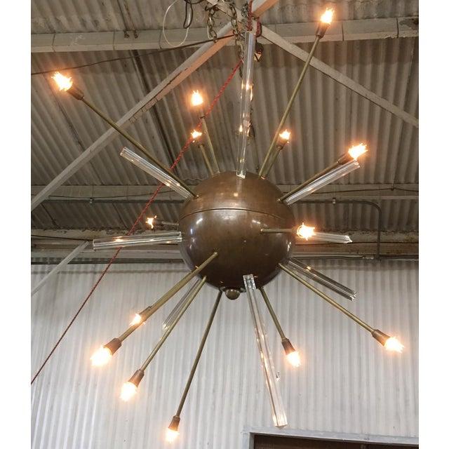 Monumental vintage Italian glass and Copper Sputnik chandelier. Although we don't know the maker, this Sputnik chandelier...