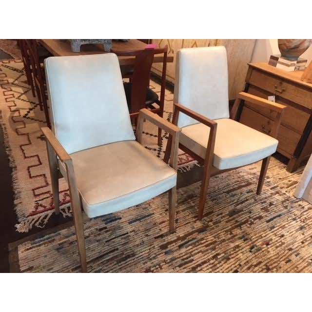Great pair of vintage French Thonet style armchairs, sold as a pair. Covered in a chic white vinyl upholstery with beech...