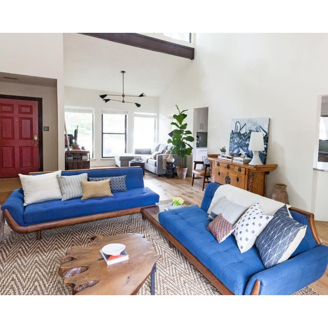 Gorgeous blue and walnut vintage mid century modern sectional that truly is a statement piece. It has always been the...