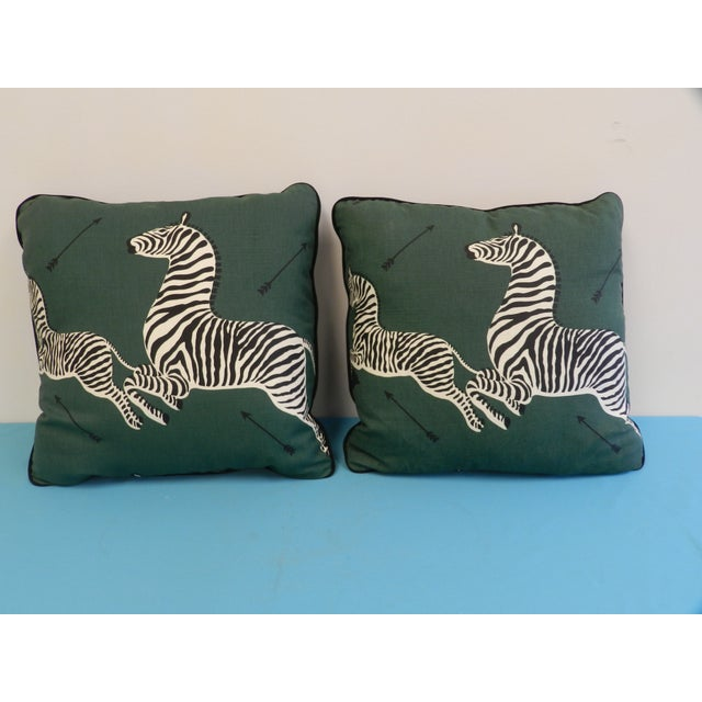 "This pair of 22""x22"" square pillows have zippers and poly fill stuffing. They are the classic Scalamandre Jumping zebras..."