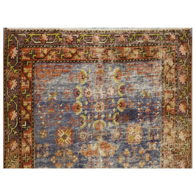 This beautiful rug is hand made, %100 wool pile. It features a pattern in a vibrant combination of red and blue and...