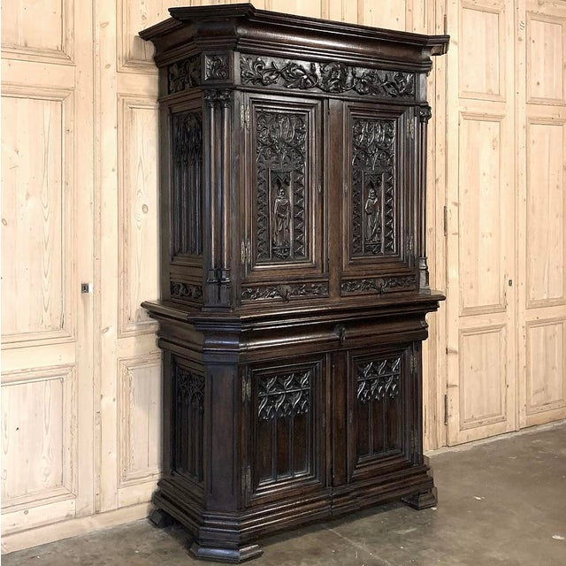 19th Century French Gothic Buffet a Deux Corps ~ Cabinet represents the epitome of classical architecture festooned with...