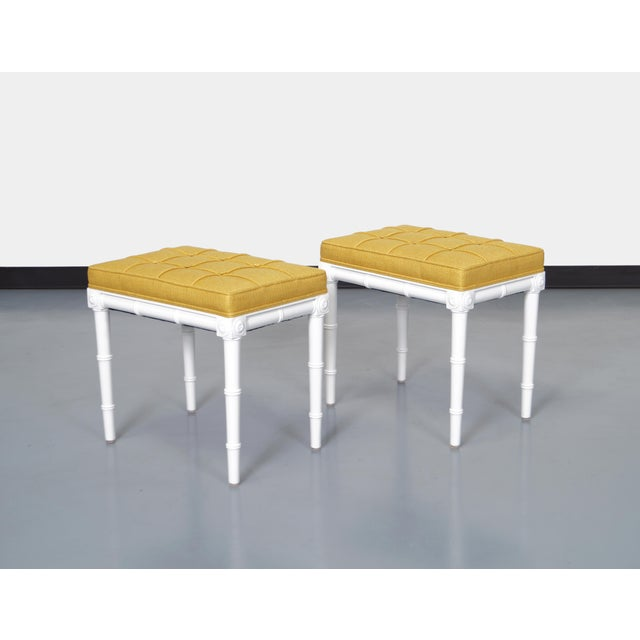 Gorgeous pair of vintage faux bamboo stools. Newly reupholstered in a knack mustard fabric.