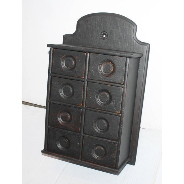 19th century black painted spice box. This spice box was found in Pennsylvania.