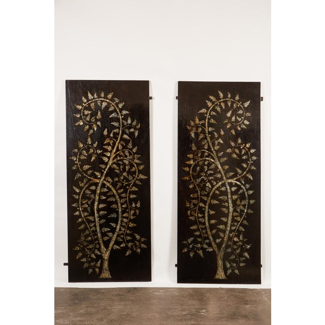 """A pair of remarkable 21st century Vietnamese rosewood slabs that features a large center """"Tree of Life"""" design comprised..."""