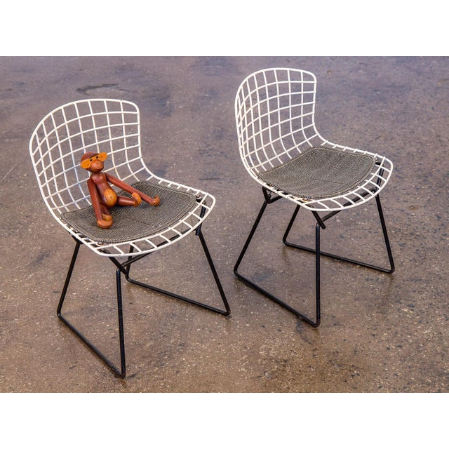 Adorable pair of vintage 1960s, baby-sized wire chairs designed by Harry Bertoia for Knoll. These miniature versions of...