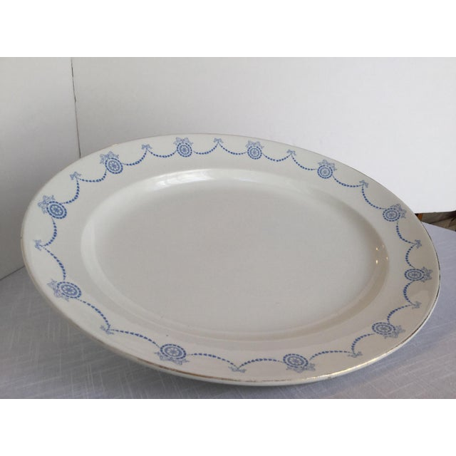Gorgeous large, heavy, deep stoneware platter. The 2 & 1/2 inch rim has a continuous garland of bows, flowers & circles in...
