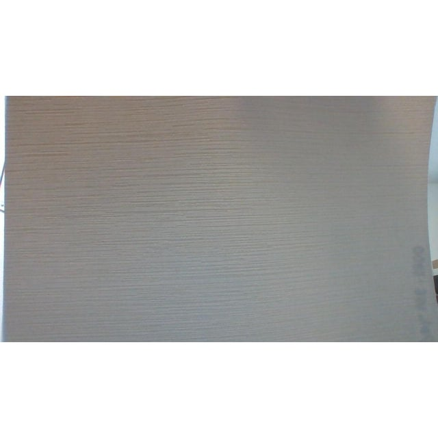Grey/Cream color wall covering with slight texture face. Manufacturer: Patty Madden Made Between: 2010-2020 Woven Back....
