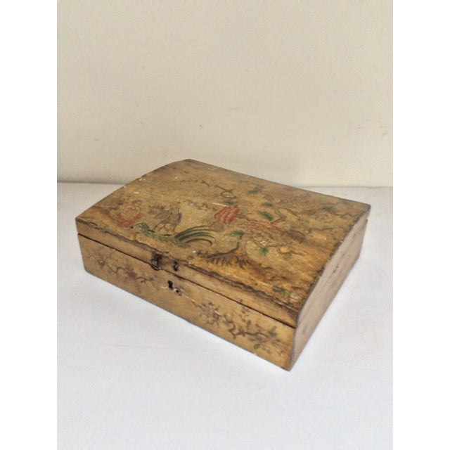 This is a circa 1800 slightly domed chinoiserie decorated box with a very worn painted finish and painted orange interior....