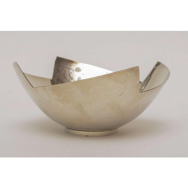 The organic and very sculptural shape of this signed silver-plate bowl for Swid Powell came from her work and line of...