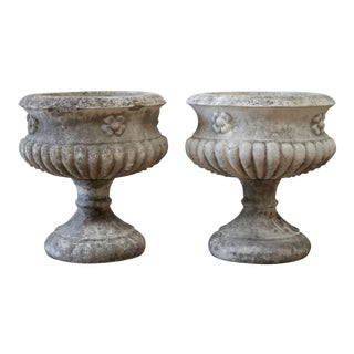 Pair of Early 20th Century Cast Stone Pedestal Urns For Sale