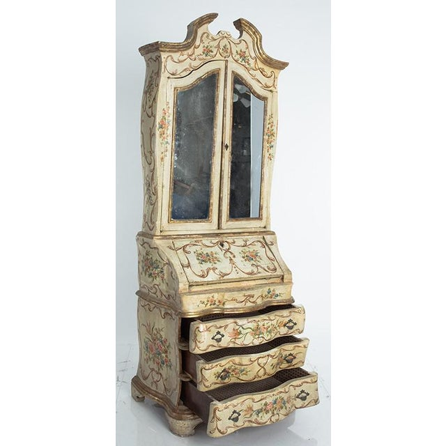 Hand painted Venetian secretary in two pieces. Original condition with gold gilt edging and mirrored doors on the upper...