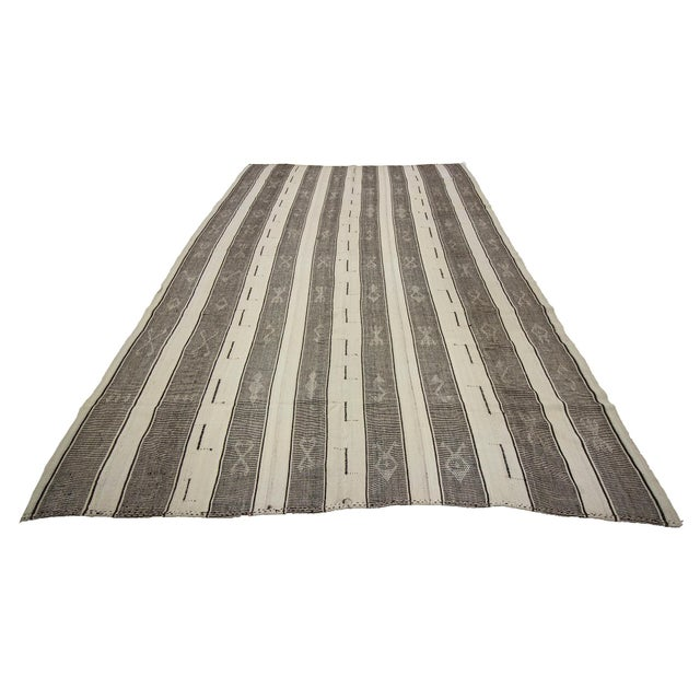 Striped Vintage modern kilim rug from Adana region of Turkey. Approximately 45-55 years old. In very good condition