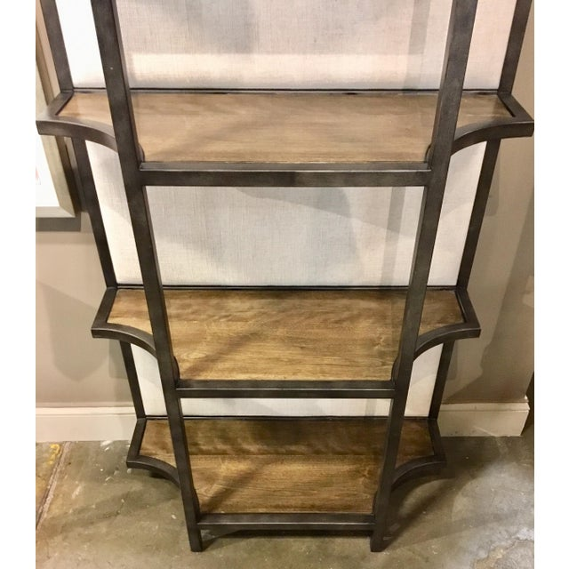 Stylish organic modern Sojourn linen back etagere, an elegant juxtaposition of linen, wood and metal, showroom floor...