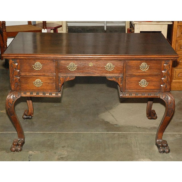 An excellent quality 19th century ladies partners desk of a smaller size in carved oak. The out turned legs have carved...