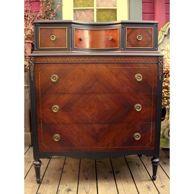 Early 20th Century Mahogany High Boy Dresser. Professionally finished in a luxurious blending of mahogany, burled walnut...