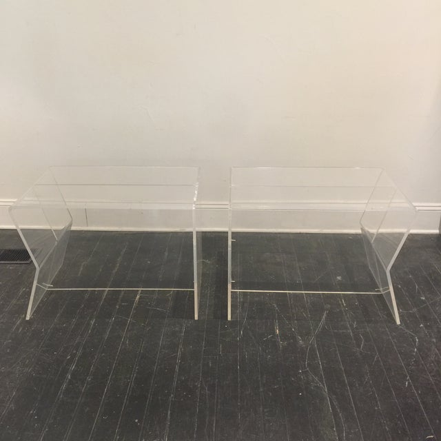Stylish pair of 1970s lucite side tables. They are clear and not cloudy as they appear in pictures. Wonderful vintage...