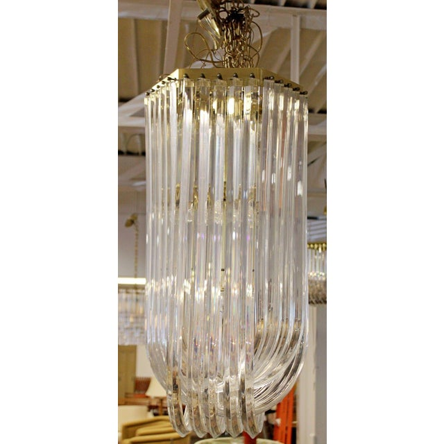 sale retailer eeb6a e3521 1950s Mid Century Modern Swag Lucite Brass Ribbon Chandelier Light