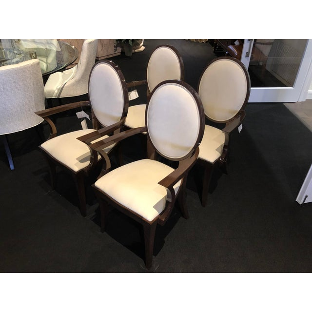 Set of six beautiful dining arm chairs. Soft ultra-suede fabric, off-white color. High-gloss dark wood finish. Imported...