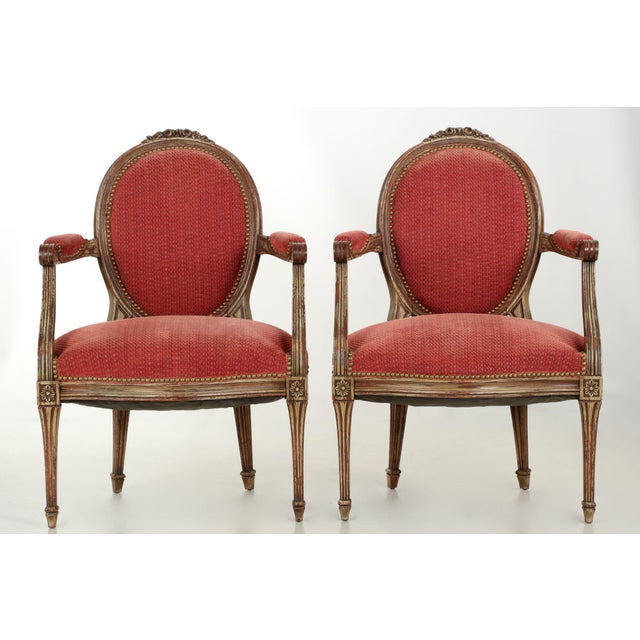 A most attractive pair of chairs in the Louis XVI taste, both have their own sense of originality of interpretation of...