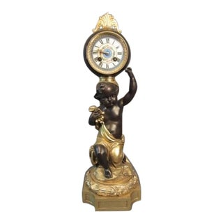Putti Figural Doré and Patinated Bronze Ball Clock For Sale
